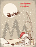 Fishing in Christmas night.Vintage winter image wi Royalty Free Stock Photo