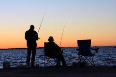 Fishing at Cleveland Point. Sunset silhouettes. Cleveland Point provides good access to Raby Bay for bream fishing and access in good conditions to Peel Island Stock Photos