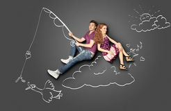 Fishing on a cloud. royalty free stock image