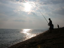 Fishing on the coast 1 Royalty Free Stock Photography