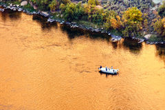 Fishing in the Colorado River. Fishing boat in the Colorado River at the beginning of Grand Canyon, Arizona Stock Image