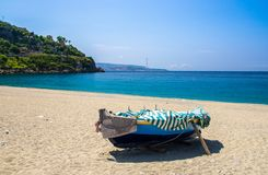 Fishing colorful boats on sandy beach, Scilla, Calabria, Italy royalty free stock image