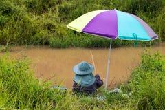 Fishing colorful umbrella. Royalty Free Stock Photography