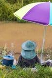 Fishing colorful umbrella. Stock Images