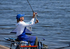 Fishing competition. VYSHGOROD, UKRAINE - JUNE 7, 2014: Fishing competition Fishing Feeder Cup of Ukraine on the municipal embankment of the Kyiv sea in Royalty Free Stock Images