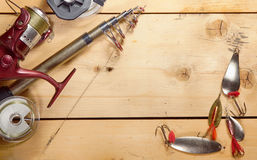 Fishing composition with angling equipment on wooden boards Stock Images