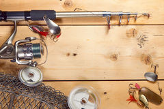 Fishing composition with a spinning and metal baits Royalty Free Stock Photo