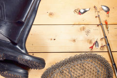 Fishing composition with various angling equipment on wooden bac. Kground Royalty Free Stock Images