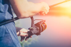 Fishing concepts. Fishing reel lake river fisherman holiday fish catching gear tench rod fisher hobbies spinning spin - stock image Stock Images