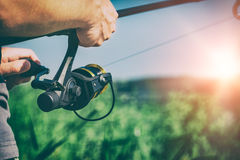 Fishing concepts. Fishing reel lake river fisherman holiday fish catching gear tench rod fisher hobbies spinning spin - stock image Royalty Free Stock Photos