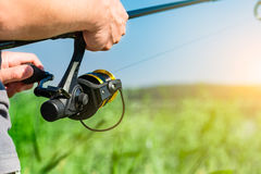 Fishing concepts. Fishing reel lake river fisherman holiday fish catching gear tench rod fisher hobbies spinning spin - stock image Royalty Free Stock Images