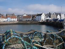 Fife traditional houses fishing harbour with lobster pots ropes in Scotland uk