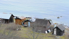 Fishing cottages next to the ocean on the island of Gotland stock video