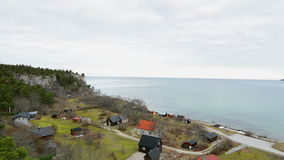 Fishing cottages next to the ocean on the island of Gotland stock video footage