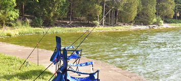 Fishing a cove at Percy Priest Lake. Your fishing chair awaits you in a secluded cove on the shore of J Percy Priest Lake in Nashville, Tennessee. This large stock photography