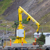 Fishing crane in small seaside Iceland town harbor Royalty Free Stock Photography