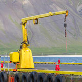 Fishing crane in small seaside Iceland town harbor Stock Images