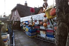 Fishing crates, buoys and other maritime objects in front of the old bar Blaue Maus on the North Frisian island Amrum Royalty Free Stock Photography