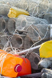 Fishing creels and colored plastic bottles used as Royalty Free Stock Photography
