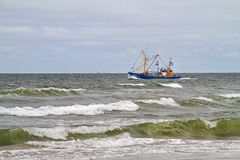 Fishing cutter and breakers Royalty Free Stock Image