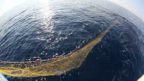 Fishing Cutter. Fishing net thrown into the sea stock footage