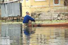 Fishing in dal lake. Royalty Free Stock Photography