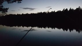 Fishing in the dark Sweden, lovely. stock images