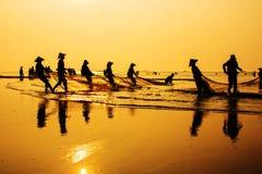Fishing in dawn Stock Photos
