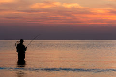 Fishing at dawn Royalty Free Stock Image