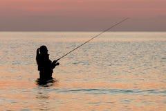 Fishing at dawn Stock Image
