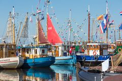 Fishing day decoratedl fishing ships in the harbor Royalty Free Stock Photos