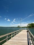 Fishing Dock. A fishing pier at a lake on a clear day royalty free stock photography