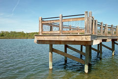 Fishing Dock. Wooden fishing dock on a small inland lake or pond royalty free stock images