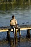 Fishing on dock Stock Photo