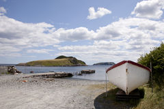 Fishing dock and boat on sunny day in newfoundland Royalty Free Stock Photos