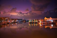 Fishing dock at dawn, Rayong. Landscape of fishing ships or boats at Pak Nam Rayong River port or dock with twilight sky and river reflection at dawn Royalty Free Stock Image