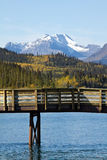 Fishing dock with lake and mountains behind Carcross, Yukon Stock Image