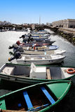 Fishing docks. Several aligned fishing boats on the docks of Olhão, Portugal Royalty Free Stock Photos