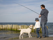 Fishing with dog Stock Image