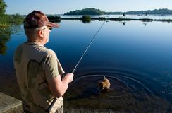 Fishing with dog Stock Photos