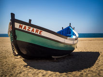 Fishing Dory on the beach in Nazare, Portugal Royalty Free Stock Images
