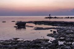 Fishing early in the morning, Cyprus. A photo with a long exposure 1 second to create the effect of soft water Royalty Free Stock Images