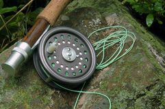Fishing Equipment. Light fly fishing rod and reel royalty free stock photography