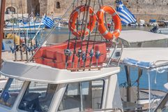 Fishing equipment on boat docked on marina in Greek town Rhodes. With lots of boats around Stock Photography