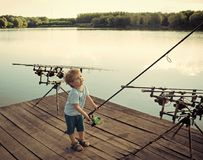 Free Fishing Equipment. Boy Fisherman With Fishing Rods On Wooden Pier Stock Photography - 118455562