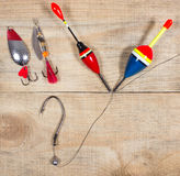 Fishing Equipment - concept of choice fishing techniques. Concept of choice fishing techniques. Question mark Royalty Free Stock Photo