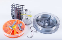 Fishing equipment. Fishing lines, hooks, sinkers and feeders Royalty Free Stock Image