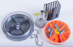 Fishing equipment. Fishing lines, hooks, sinkers and feeders Stock Photography