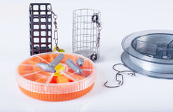 Fishing equipment. Fishing lines, hooks, sinkers and feeders Royalty Free Stock Images