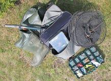 Fishing equipment on grass Royalty Free Stock Image
